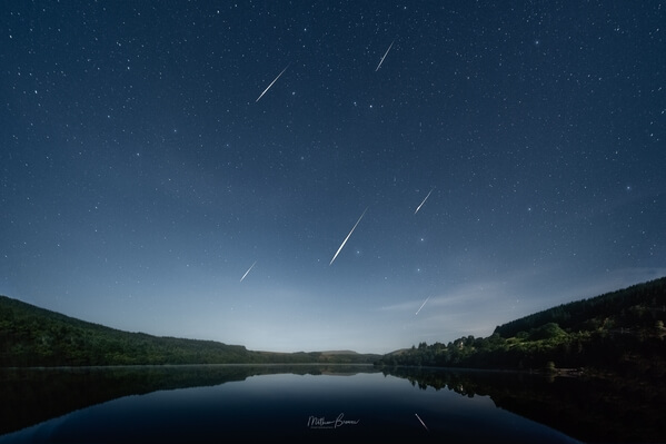 Composite of several Perseid meteors over the reservoir