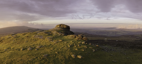 A Winter sunrise standing on Haytor looking west at Lowman's Rock.