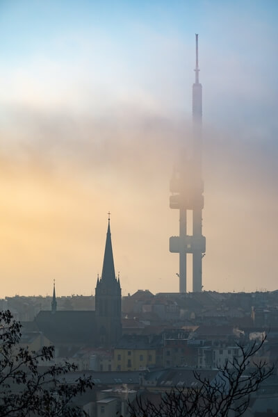 Morning autumn fog running over the Žižkov district with the dominant of Television Tower