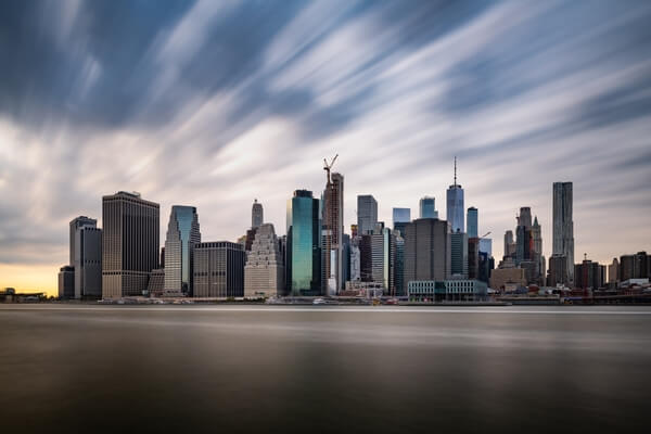 Moving clouds above the Lower Manhattan panorama.Long exposure shot.
