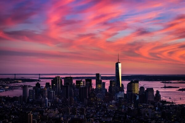 Colorful sunset behind the Lower Manhattan, as seen from the Empire State Building