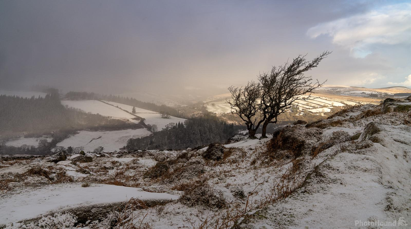 Yar Tor looking northwest on a snowy sunset in winter.