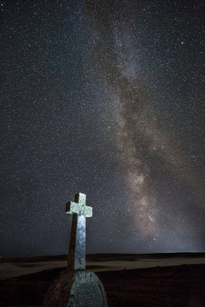 Cave Penny Cross in September with the milky way core behind (with an inversion in the valley behind)