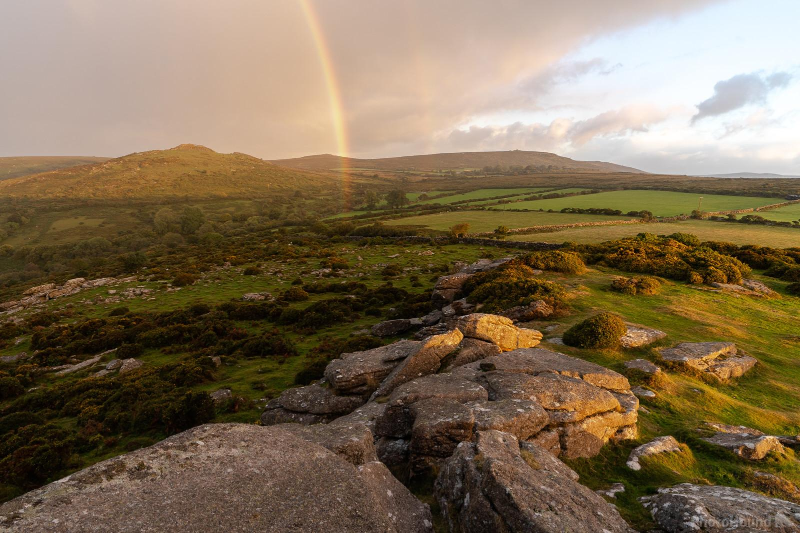 A pink sunrise rainbow looking north west towards Sharp Tor on a spring sunrise.