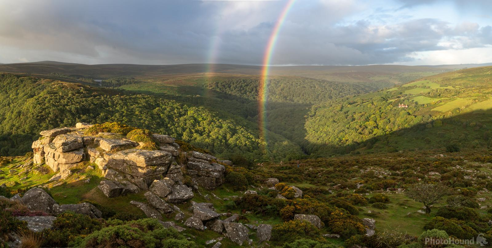 A double sunrise rainbow looking south west towards Sharp Tor on a spring sunrise.