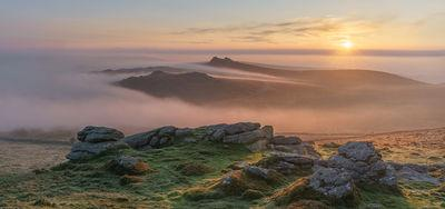 Summit of Rippon Tor looking north east on a late spring sunrise during an inversion and hill fog.