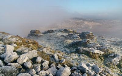 Summit of Rippon Tor looking north east on a winter sunrise during an inversion and hill fog.