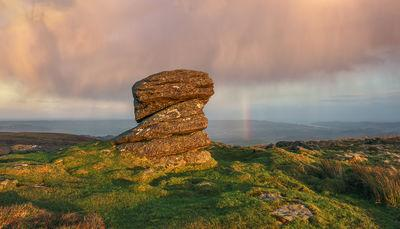 Summit of Rippon Tor looking east on a autumn sunset  as a rain shower passes.