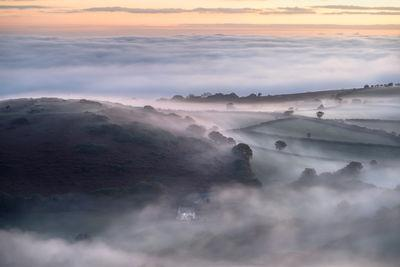 A view to Nattadon Hill on a spring sunrise during a temperature inversion.