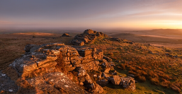 A late winter sunrise looking east of the most iconic stacks on the tor.