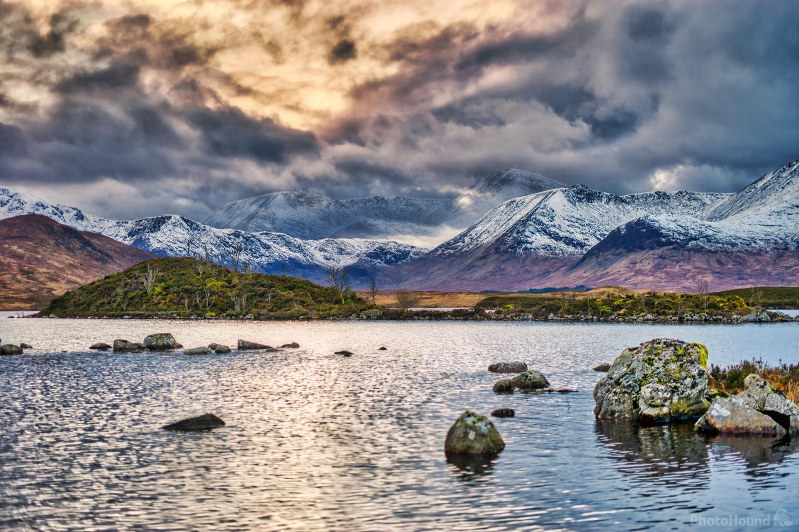 Sunset over the snowy mountains behind Lochan na h-Achlaise