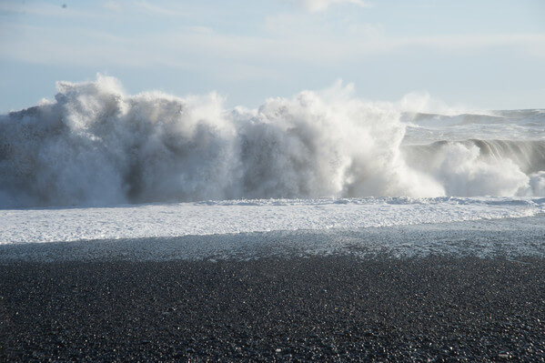 Fierce waves crashing onto the beach