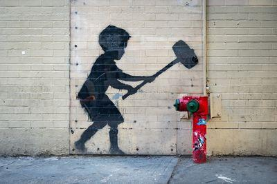 Hammer Boy mural by Banksy