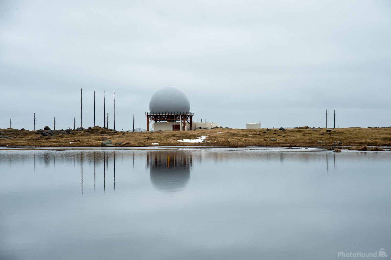Radar station reflected in a pool