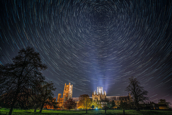 Star trails work well, as Polaris is directly above the illuminated tower