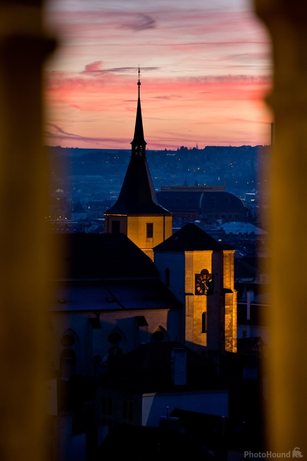 View through the window of Old Town Hall Tower after sunset