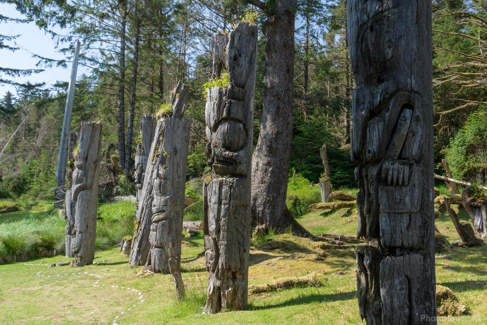 Monumental poles of the Haida Heritage Site of S'gang Gwaay Llnagaay