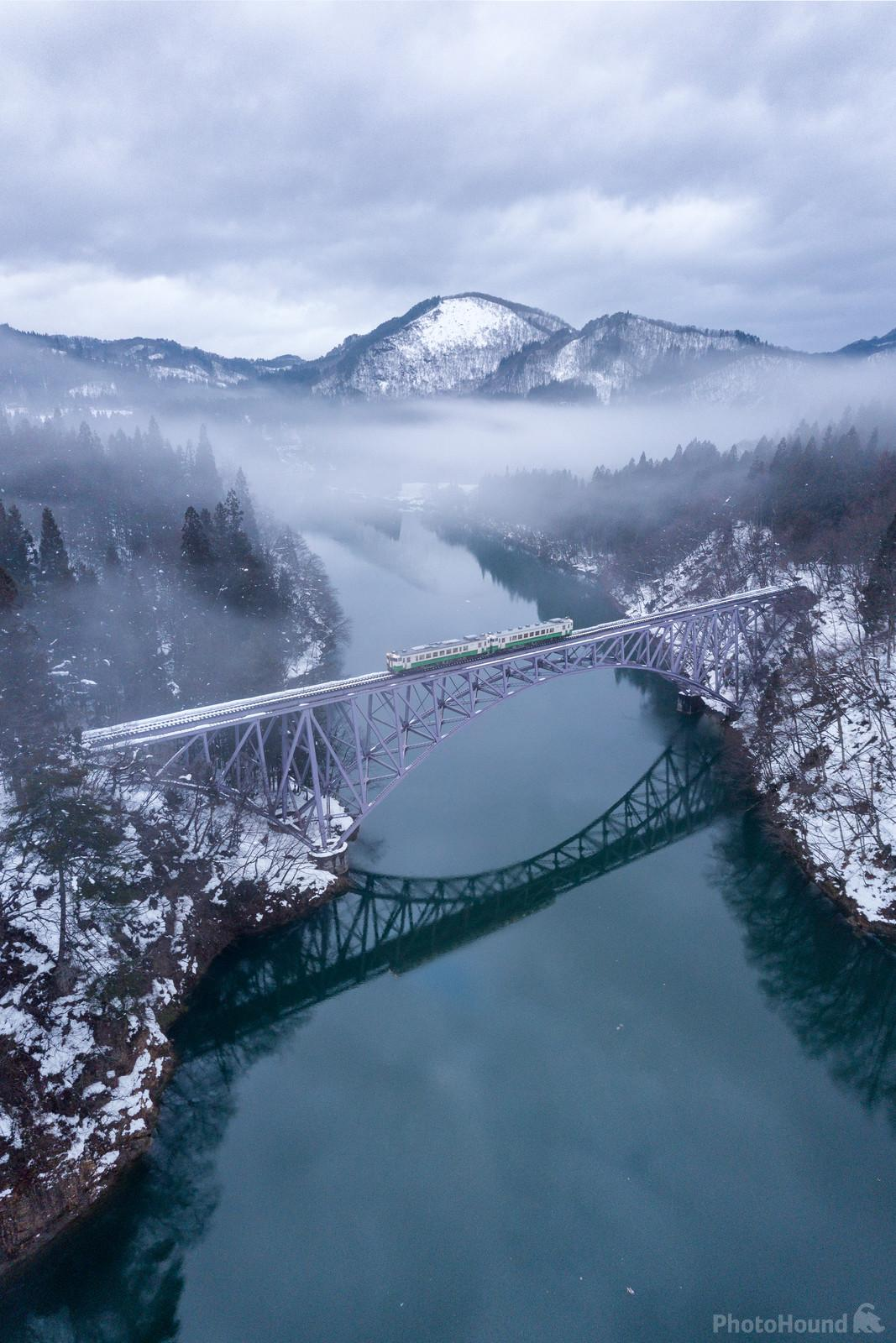 A drone photo of the bridge with a local train.