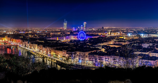 Lyon during the festival of lights 2016 seen from the Garden of Curiosities. We can see the towers of the Part Dieu district and the big wheel on the Bellecour square.