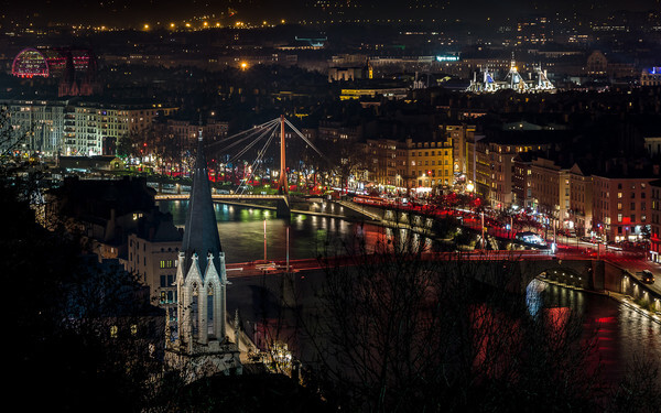 Lyon seen from Curiosités garden during the Festival of Lights. We can see in the foreground the church of St. George and the Bonaparte bridge on the Saone and in the background, the Chamber of Commerce and Industry and the opera of Lyon.