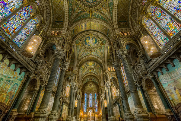 "Inside of Fourviere Basilica at Lyon. The Notre-Dame de Fourvière basilica overlooks the city of Lyon from the top of the Fourvière hill since the end of the nineteenth century. It is one of the most visible landmarks of the agglomeration and symbols of the city of Lyon. It gives Lyon its status as a ""Marian city"". About two million tourists are welcomed each year in the basilica."