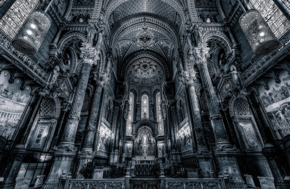 "Inside of Fourviere Basilica at Lyon in B/W. The Notre-Dame de Fourvière basilica overlooks the city of Lyon from the top of the Fourvière hill since the end of the nineteenth century. It is one of the most visible landmarks of the agglomeration and symbols of the city of Lyon. It gives Lyon its status as a ""Marian city"". About two million tourists are welcomed each year in the basilica."