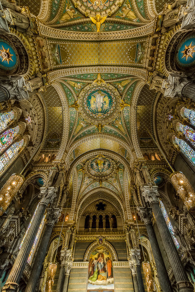 "Ceiling of Notre Dame of Fouviere Basilica in Lyon. The Notre-Dame de Fourvière basilica overlooks the city of Lyon from the top of the Fourvière hill since the end of the nineteenth century. It is one of the most visible landmarks of the agglomeration and symbols of the city of Lyon. It gives Lyon its status as a ""Marian city"". About two million tourists are welcomed each year in the basilica."