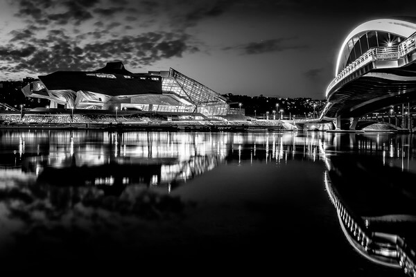 The Confluences museum and the Raymond Barre footbridge on the Rhone at Lyon in the Confluences district in B/W.