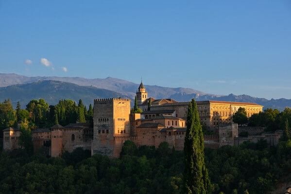 Nice blue skies and sunset shining on the walls of Alhambra