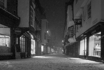 An empty Stonegate during a night time snowstorm