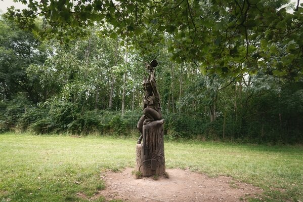 Carved wooden sculpture on the Wood Vibrations Trail