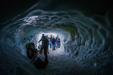 Paragliders  in ice tunnel