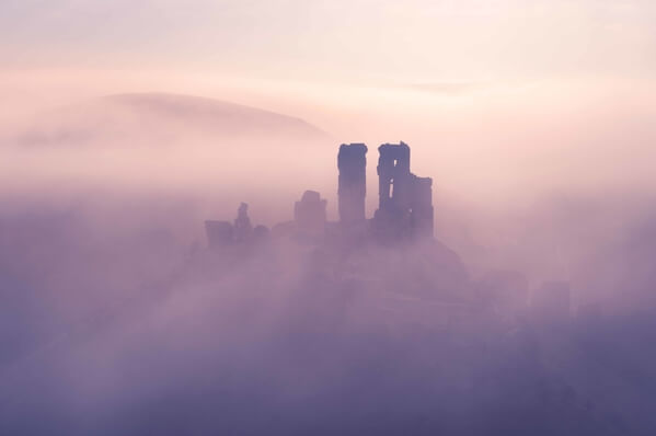 Corfe Castle is at its finest, during the spring and autumn months when mists swirling round the castle are most likely.