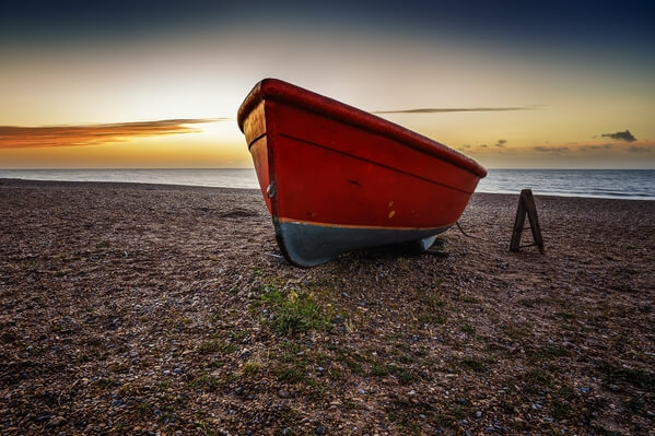 Small red boat on the beach