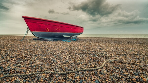 The little red boat in winter, overcast day