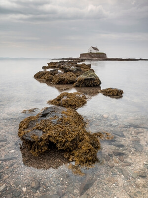 Long exposure with the rocks exposed by the low tide