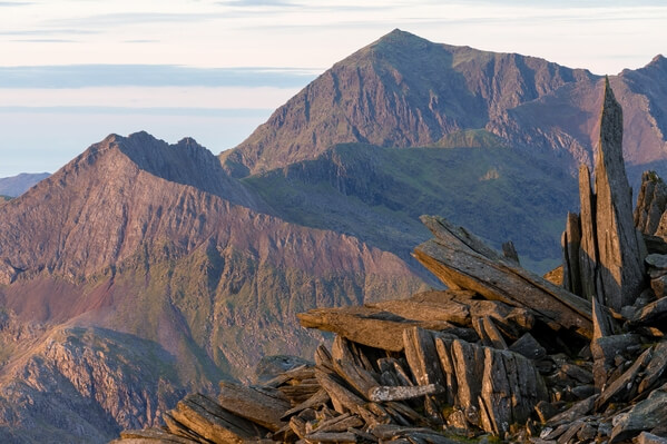 A telephoto shot of part of the castle with Crib Goch and Snowdon in the distance.