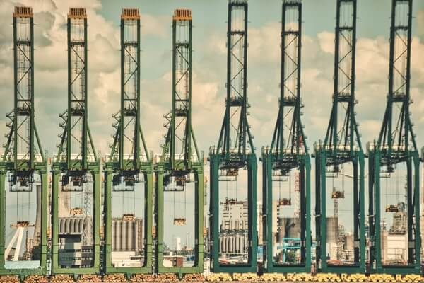 Cranes line-up at the container terminal across the river;