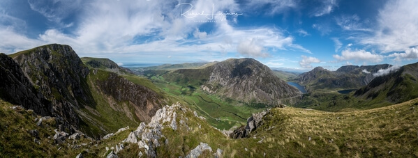 Large panorama from the Ogwen valley on the right to the valley that leads out to Anglesey on the left.