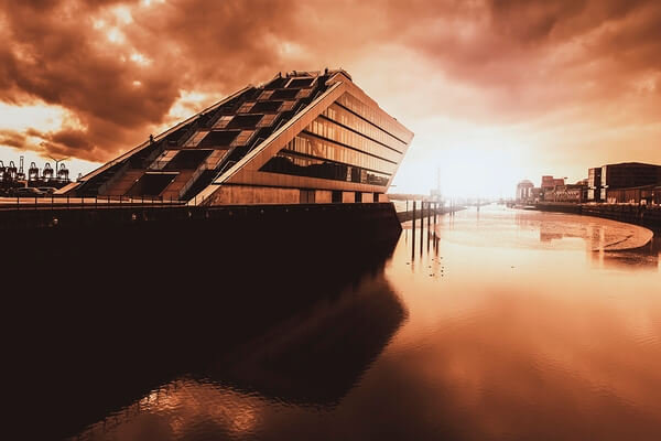 The Dockland building is located on the north bank of the river Elbe opposite the Hamburg container terminal.