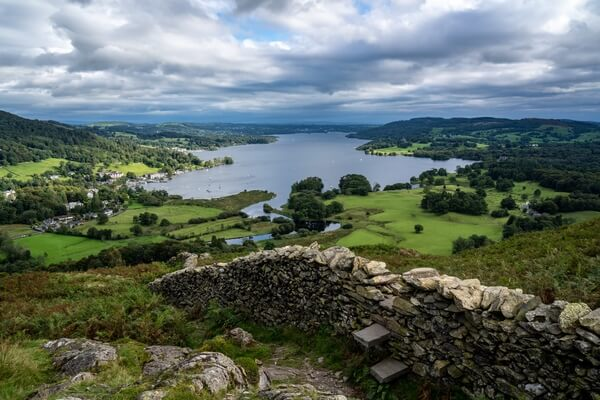View over Windermere from Loughrigg Brow. The wooden stile has been replaced with stone steps.