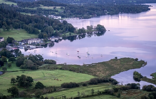 Telephoto shot of boats on Windermere at dawn