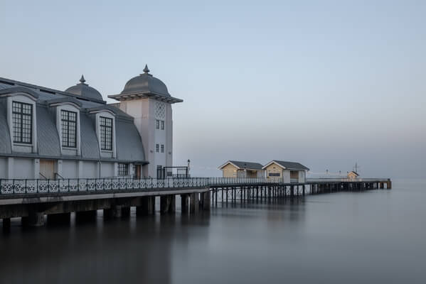 Penarth Pier, early in the morning with the tide in.  Slow shutter speed to smooth out the water.