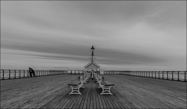 The end of the pier, towards the sea.  Taken on a bracing summers day in July!