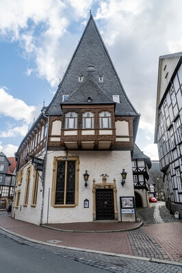 Hoher Weg - behind the market place. The building is adorned with intricate wood carvings including the famous saucy dairymaid who scratches her bare bottom whilst churning the milk.