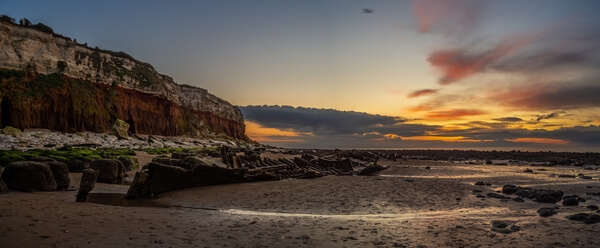 Panoramic shot during the sunset. Low tide required to go this spot.