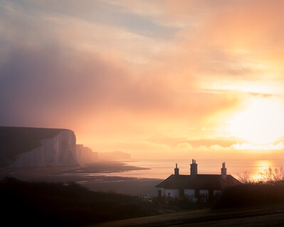 Golden winter sunrise over the coastguard cottages. The seven sisters featuring in the background.