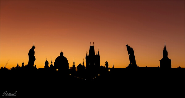 Charles Bridge silhouette on a crowded morning in september