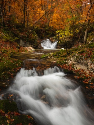 A small waterfall of the Mostnica river in autumn
