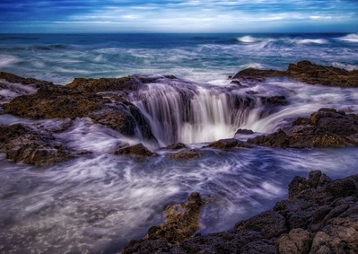 Although Thor's Well is best shot at high tides, this shot taken at a lower tide but with  considerable storm surge.